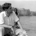 Gerald Durrell in a canoe on the Cross River, near Mamfe