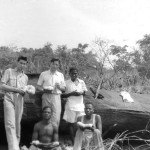 Me, Gerald Durrell and local hunters holding eggs of an African python. The female python, brooding its eggs, had been discovered by the hunters beneath the rocky outcrop behind us and they had removed the eggs before we reached the site.