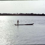 Man and canoe. River Niger, near Foge Island, Nigeria, May 1968. Foge Island was soon to be submerged by the construction of the Kainji Dam and the creation of Kainji Lake.