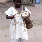 Young boy with talking drum, near Oke-Iho, Nigeria. 1968.