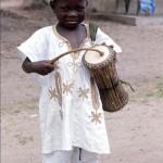 Young boy with talking drum, near Oke-Iho, Nigeria. 1968.
