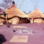 Constructing new huts or houses in the village of Kouande-Guessou, Republic of Benin, 30 March 1964. Benin, or Dahomey as it was then called, lies to the west of Nigeria.