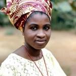 A professional Yoruba woman dressed in a typical Yoruba outfit. The predominant ethnic group of the Ibadan area is Yoruba. University of Ibadan, 1970.