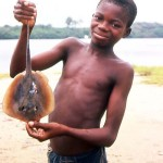 Boy with small ray at Bar Beach, Lagos, 23 May 1964.