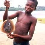 Boy with small ray at Bar Beach, Lagos, 23 May 1964.