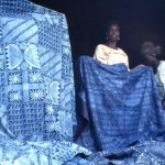 Adire cloth for sale in Dugbe market, Ibadan. Adire, which translates as tie and dye, is the name given to indigo dyed cloth produced by Yoruba women of south western Nigeria. 1977.