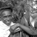 This man brought the mona monkey for sale to the Zoological Garden, University of Ibadan. The monkey had been raised by its owner from a youngster and was completely tame. 1965.