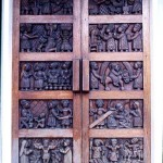Another set of doors of the Catholic Church, this time with carved wooden panels. 1979.