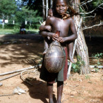 Young girl with baby and calabash, Bafut