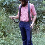 I am holding a black cobra (Naja melanoleuca) that was captured and killed on the University of Ibadan campus, 11 October 1972. It measured 8 ft. 4 in. in length and weighed 8 lb. 1 oz.